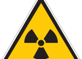 What is the cause of the negative impact of radiation on living things